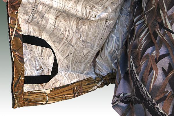 Дополнительная точка крепления в виде петли на нижней внутренней части куртки (для комеля спининга)